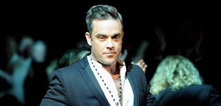 Robbie Williams may miss birth of his child