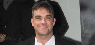 Robbie Williams becomes a dad