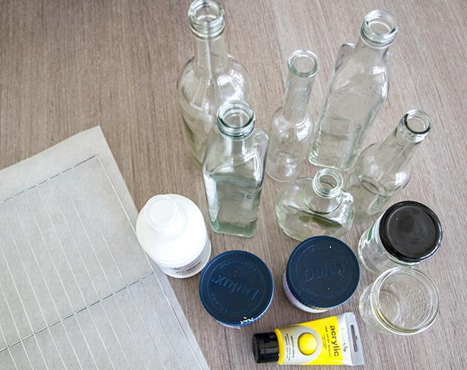 Make your own painted glass vases   Materials: Old jar with a lid (to mix paint) Paint Water Glass bottle or jar, cleaned and dried Old baking rack or newspaper