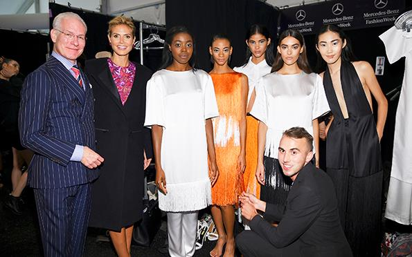The Kiwi designer with his collection and Project Runway co-hosts Tim Gunn and Heidi Klum.