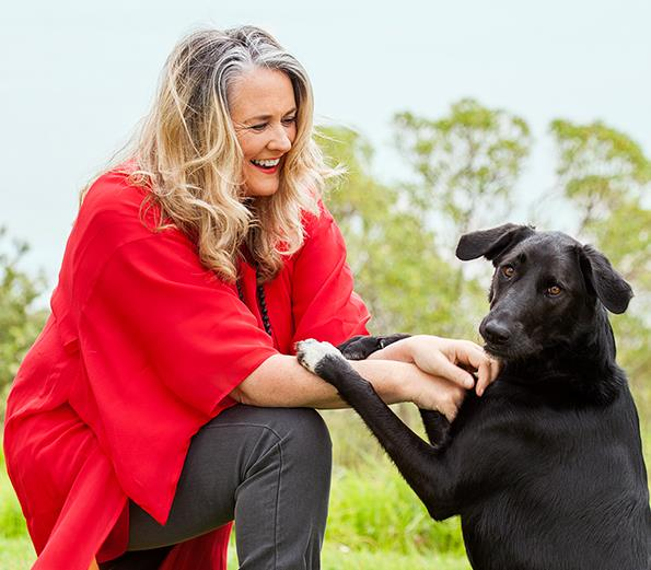 Wendyl has replaced high heels for gumboots to chill with Rosie the dog.