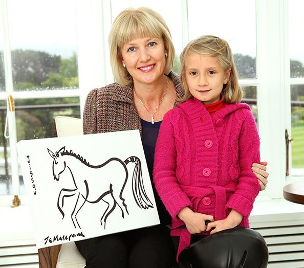"Janine proudly displays her ""doodle-horse"" with young Mareikura by her side."
