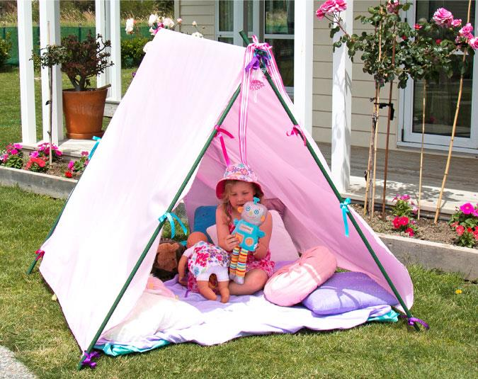Step 5.  Cover the ground in the tent with the other sheet, add cushions and toys, then let your little ones' imaginations run wild!