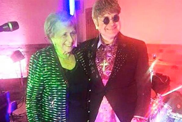 Elton John's mother hired a lookalike to attend her 90th birthday bash.