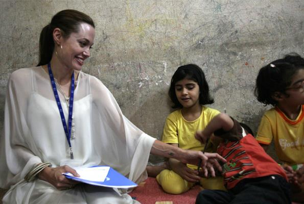Angelina made strong bonds with a Syrian family living in Iraq on a trip with Brad in 2009.