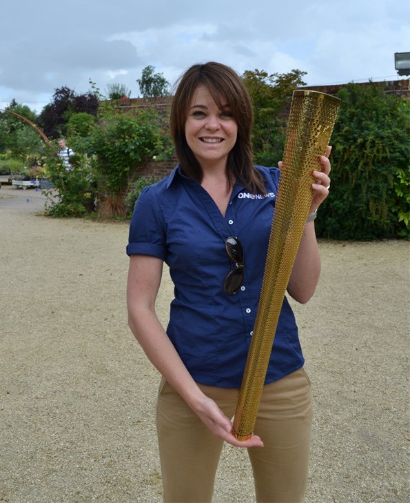 Heather poses with the Olympic torch, on loan for the photo only