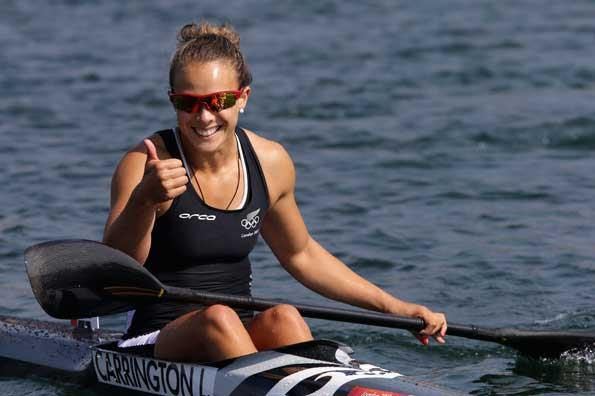 Lisa Carrington gives the thumbs up after winning gold