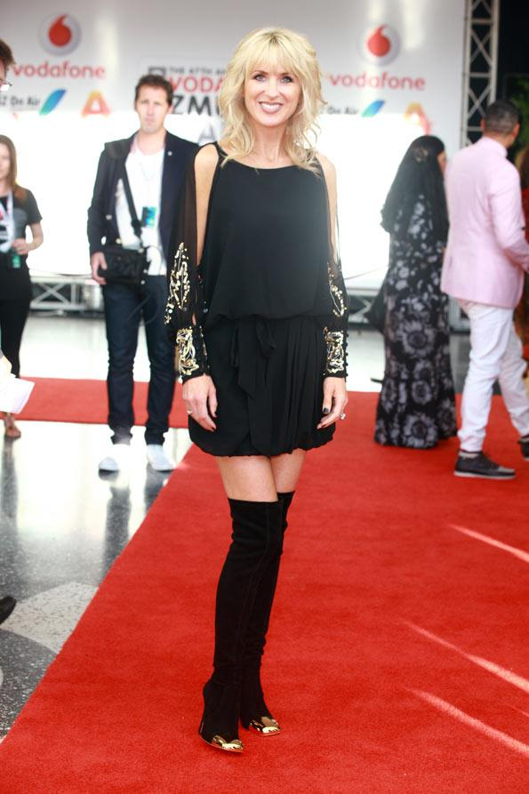 Former radio and TV presenter Kate hawkesby paired thigh-high boots with a little black dress.