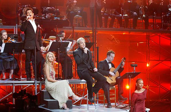 Geoff (middle), pictured performing as part of his hit operatic pop group Amici Forever.