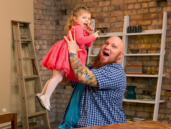 Lee, with daughter Lucy, gave up beer for a year to complete his tattoo collection.