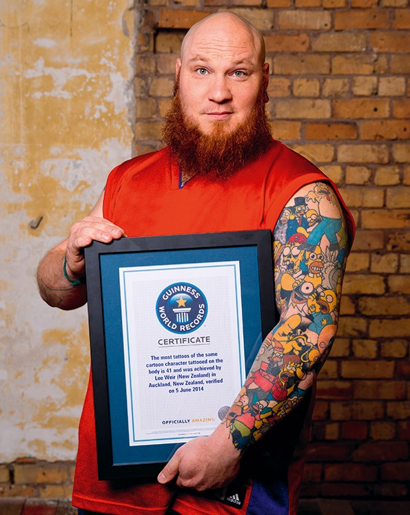 Lee holds his Guinness World Records award.