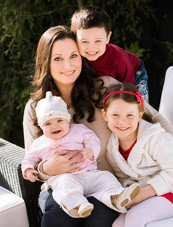 """Sarah, pictured with Reuben, Isabella and baby Charlotte, says she's """"95% back"""" to her old self since the strokes."""