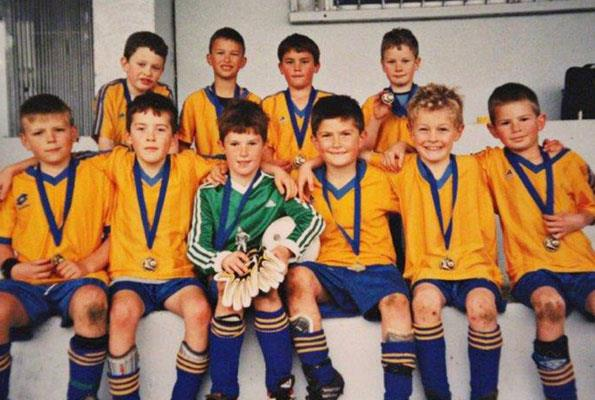 """""""Sam (in the centre wearing green) was a tall boy compared to his team and he had a big kick,"""" says Liz."""