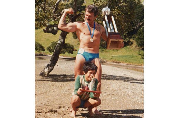 Adrian with his bodybuilder father Ray, who won Mr New Zealand three times.