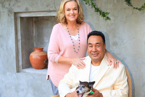 The workaholic couple, pictured with their dog Holly, say ambition is what makes their relationship work.