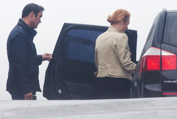 The redhead's rumoured squeeze displayed some princely manners as he helped her into a car outside a restaurant in Asturias, Spain.