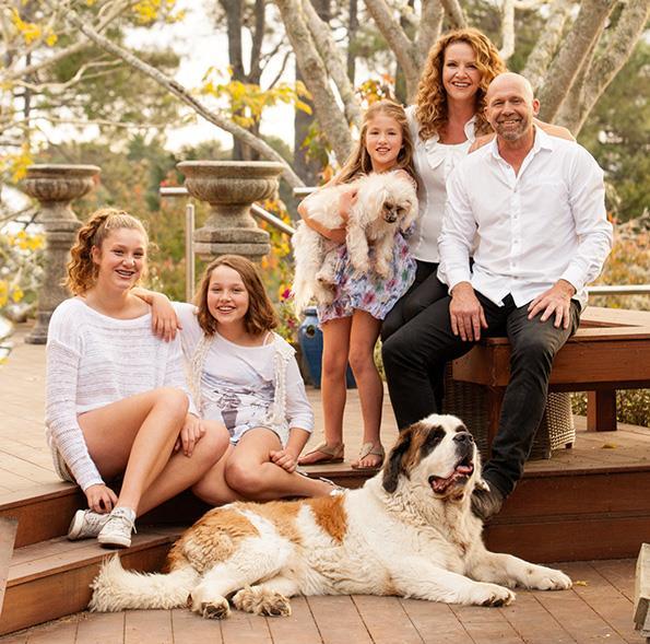 Karen Scott with husband, former All Black Mark Finlay and their children.