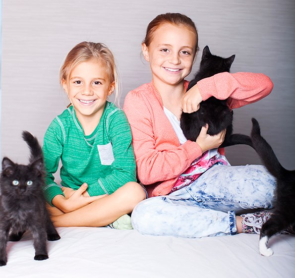 The youngsters run a cat-minding business together, and say owning a company is child's play.