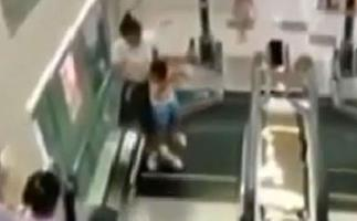 A mother has died after saving her toddler from faulty escalator.