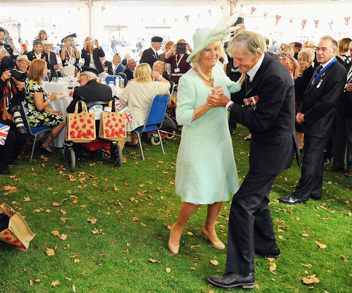 Camilla charms at a reception for VJ Day celebrations, showing the public the woman who stole Charles' heart.