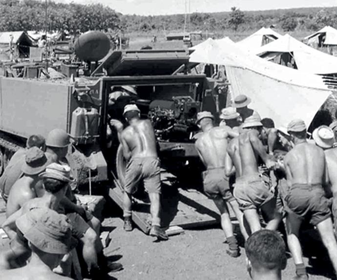 New Zealand gunners loading an L5 Howitzer into an armed personnel carrier.