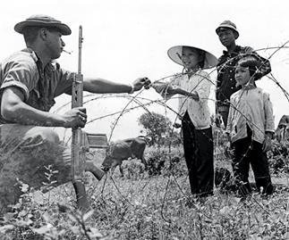 Kiwi soldier with Vietnamese children, 1969.