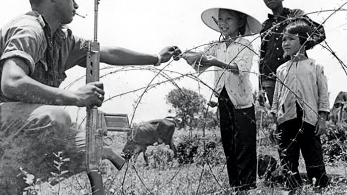 Kiwi soldier with Vietnamese children, 1969.