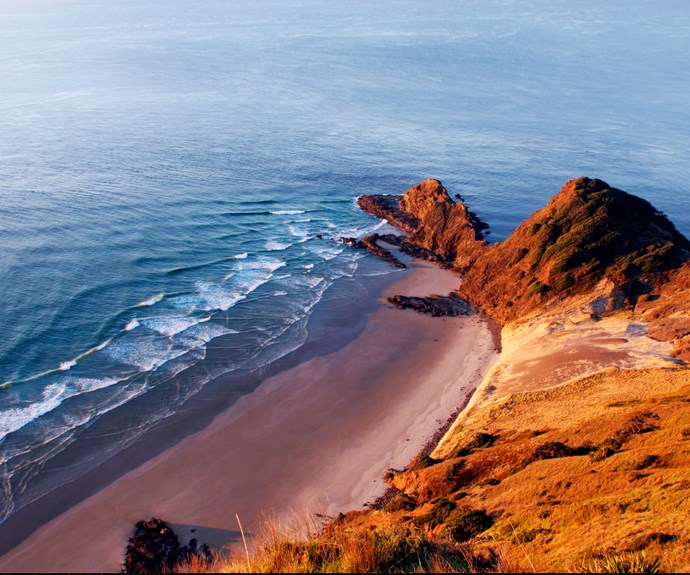 An aerial view of Cape Reinga shows how this rugged point juts out into the vastness of the ocean.