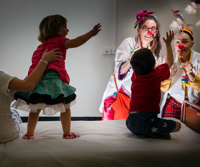 Clown Doctors Ruth Dudding (left) and Zack McCracken entertain Isabella Powell, 11, Sia Fernandez Macdonald, two, and Mika Smith Anderson, three, at Auckland's Starship children's hospital.