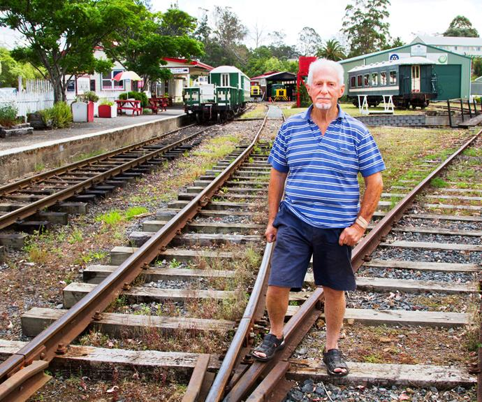 Mike Bradshaw with steam train station in background.