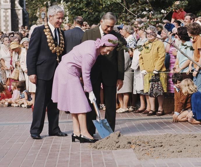 Queen Elizabeth plants a tree in Christchurch during her tour in 1977.