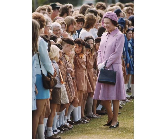 Queen Elizabeth meets some children during her visit in 1977.