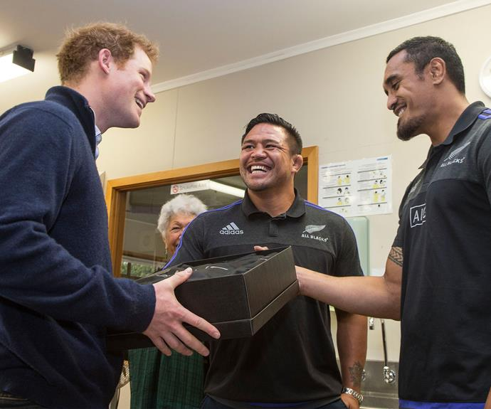 Prince Harry is presented an All Blacks jersey by Keven Mealamu and Jerome Kaino earlier this year.
