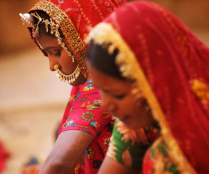 Colourful sari-clad women.