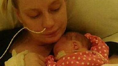 Mother wakes from coma to discover she has a seven-week-old baby girl
