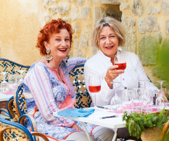 Bonding over bullfights! Peta and her neighbour Gina enjoying a glass of wine and a gossip.