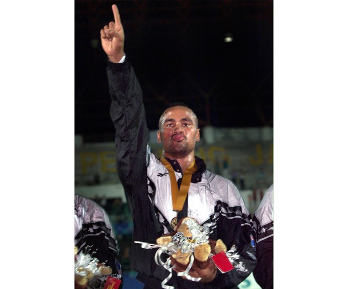 Celebrating during the Commonwealth Games medal ceremony in 1998.