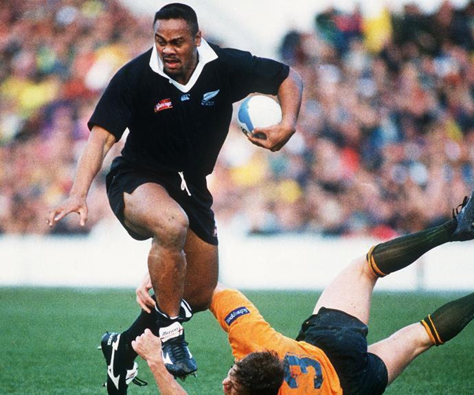 The All Black slips past the tackle of Australia's Jason Little during a Bledisloe Cup test match in 1995.