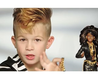 Little boy in Moschino Barbie commercial
