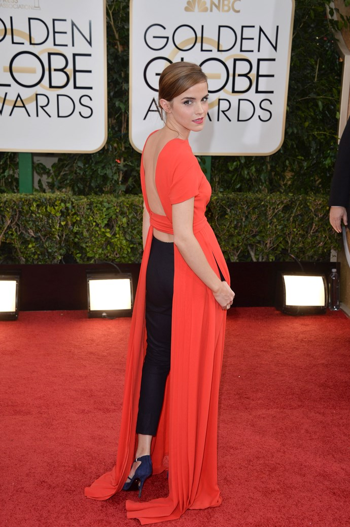 Emma Watson was racy in red and dared to try something different by wearing pants underneath in 2014.