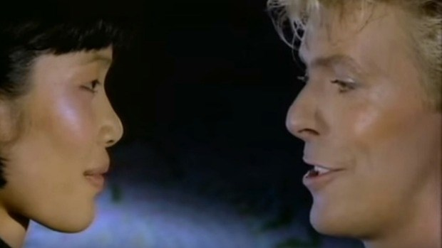 Geeling Ng with David Bowie in *China Girl*.