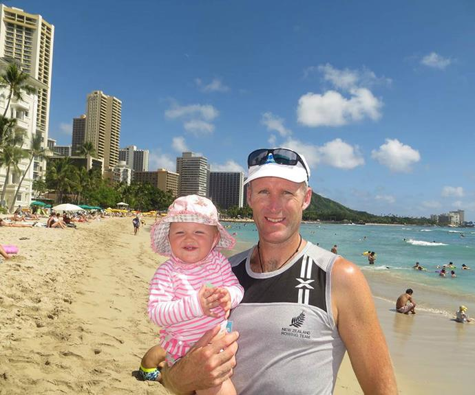 Outside the Westin Moana Surfrider hotel with his water baby.
