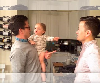 Adorable baby gets confused by twin dad