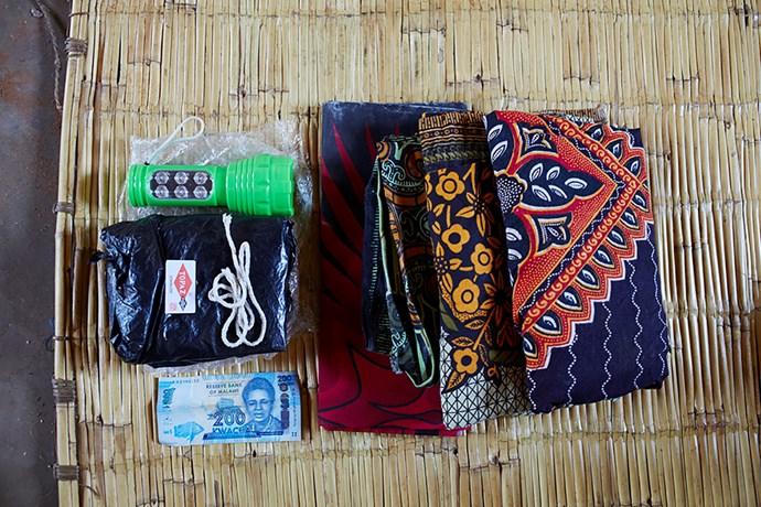 **Ellen Phiri, 23, Malawi:** Torch, black plastic sheet, razor blade, string, 200 Malawian Kwacha note and three large sarongs.
