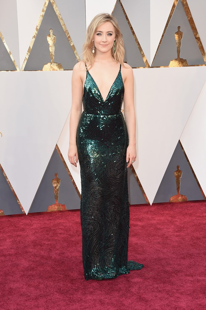 *Brooklyn* star Saoirse Ronan arrives at the 88th annual Academy Awards. She is nominated for Best Actress.