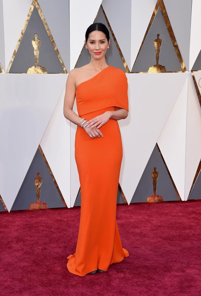 Olivia Munn arrives at the 88th annual Academy Awards.