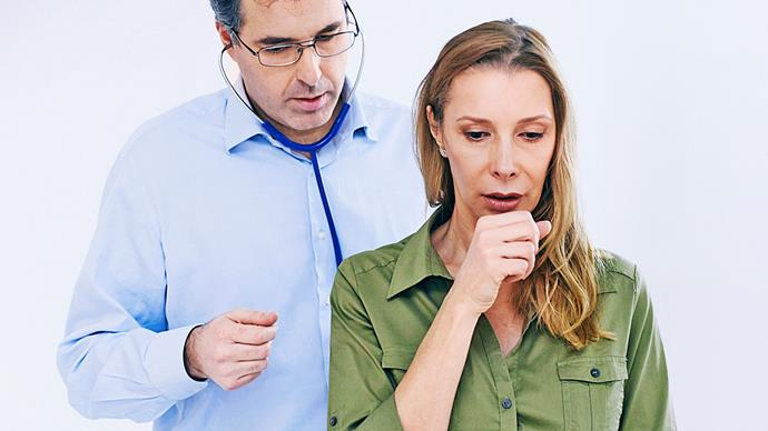 Woman having asthma attack