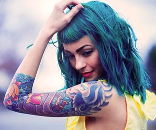 Girl with green hair and tattoos