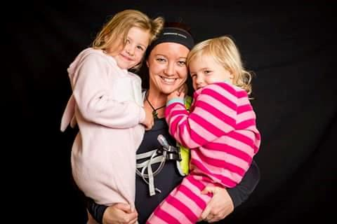 Mel with her two daughters (and training gear)