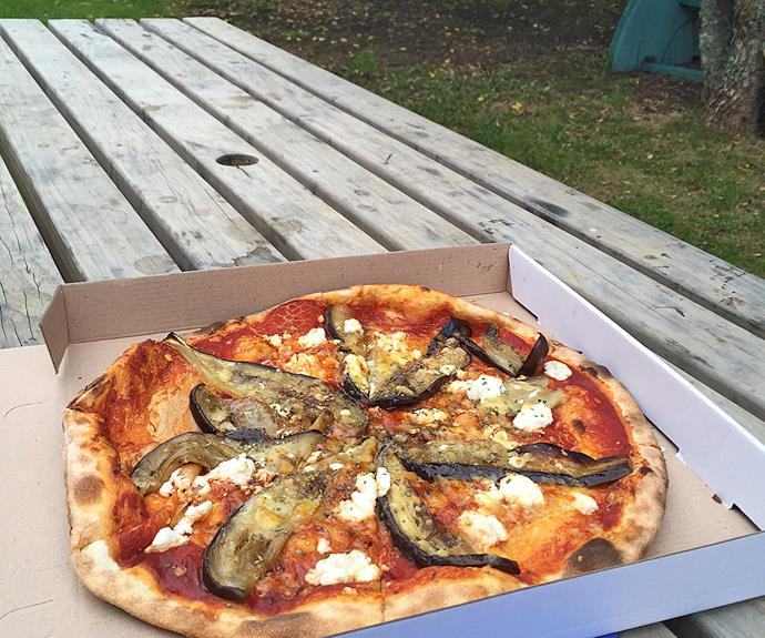Munch on wood-fired perfect pizza from Chez Louis and enjoy the sea views.